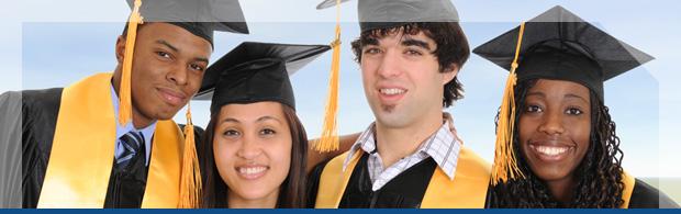4 Graduates in cap and gown